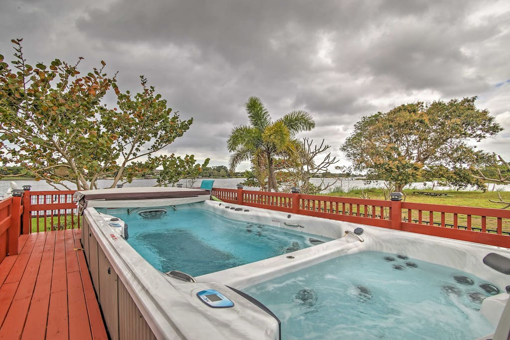 The lakefront property offers a heated swim spa and hot tub, shared with the other unit on the property.