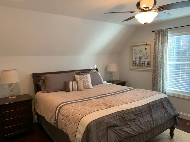 Spacious third bedroom upstairs with King sized bed and television with Roku. A roll away twin sized bed is stored in the closet.