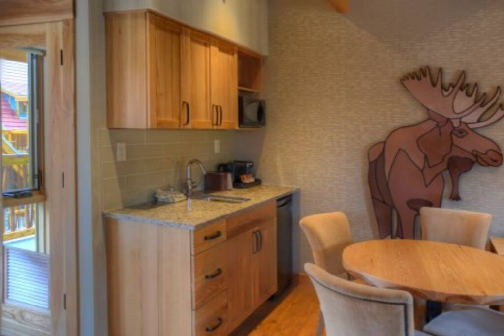 The suite has a small kitchenette with sink and fridge