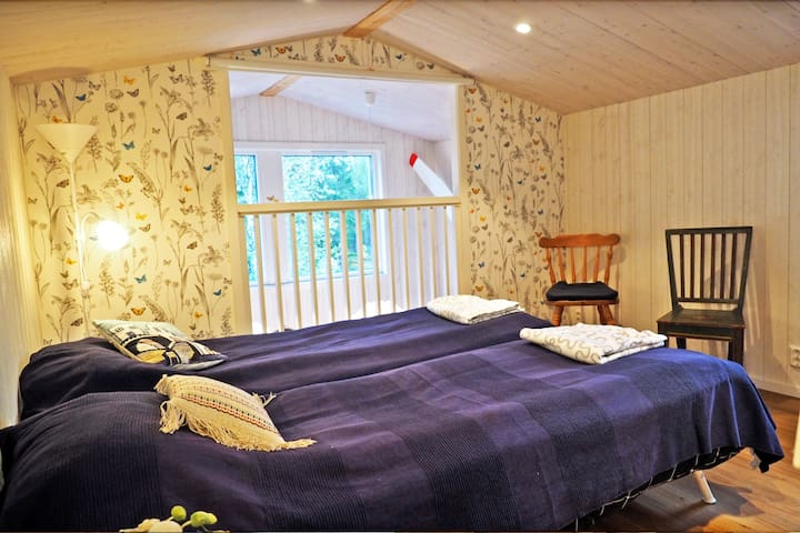 A nice bedroom in the attic with mountain views (extra bed available).  You can look down on the kitchen / living room on the ground floor. Where there is a sofa bed for two.