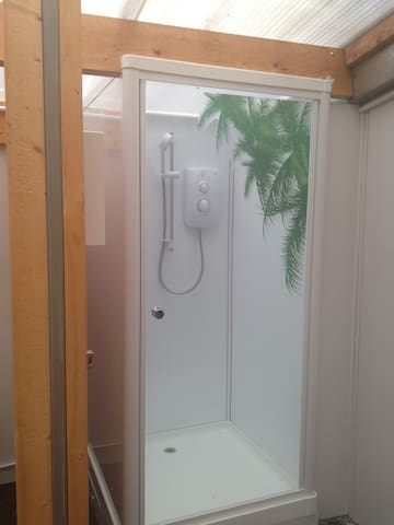 Our two showers were completed Aug 2018 - they are on a token system to help save the environment :)