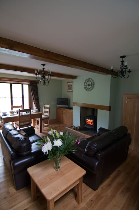 The cosy lounge and wood burner, the tv has been updated though!