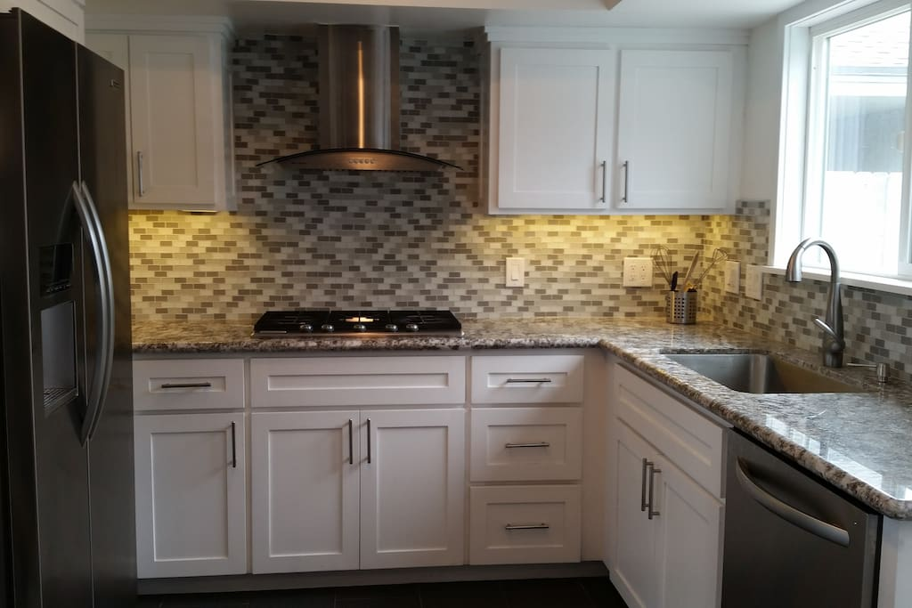glass mosaic backsplash, spacious,wide and open