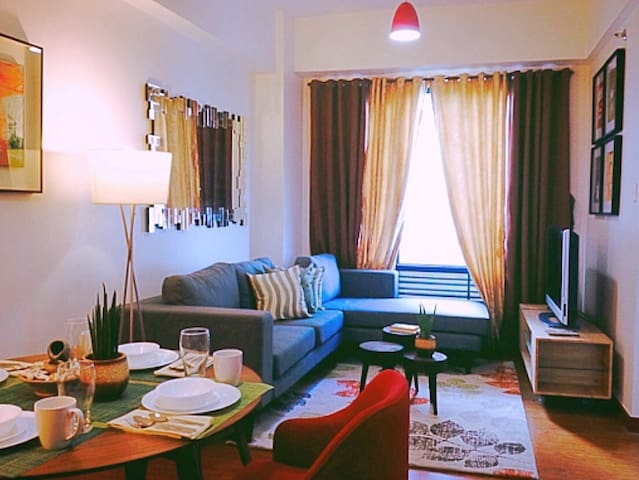 Cozy 1BR Condo at Eastwood Q.C.