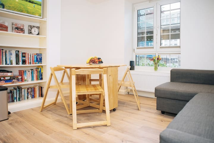 Living room with folding table and chairs