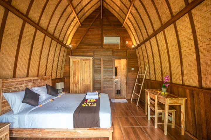 The wooden bungalow, created from original teak in Jepara. This bungalow will be your place to stay. Have a comfy double bed & private bathroom inside that.