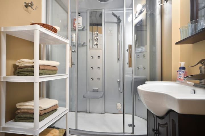 A shower extravaganza.  Its also a steam room with seats to relax , built in radio along with mood lights to set to your delight.