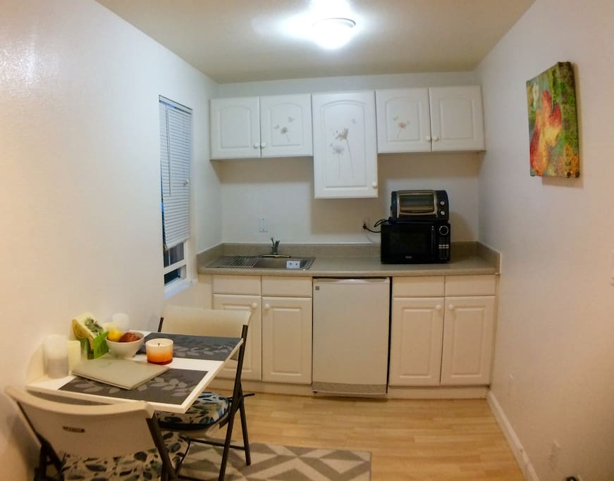 Kitchenette with micro, toaster oven, hot plate, mini fridge, and cooking/dining essentials