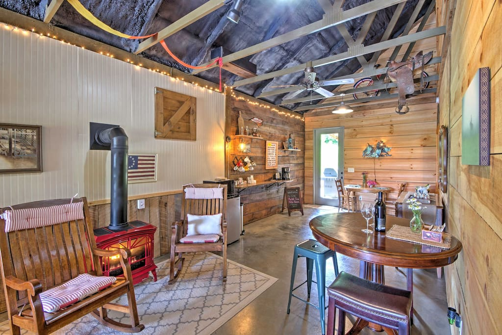 The home's interior features country themed accents and string lights for added ambiance.