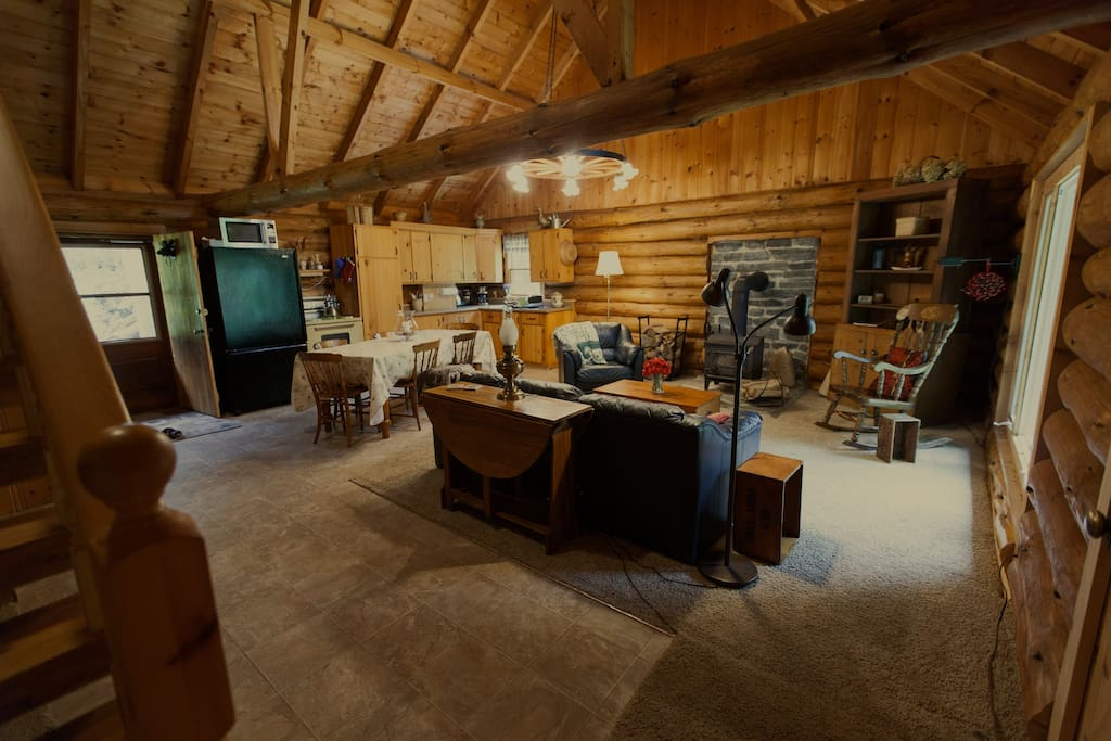 The great room is a fantastic space to cook, eat and relax. It has a wood stove, making it comfortable in the fall and spring.