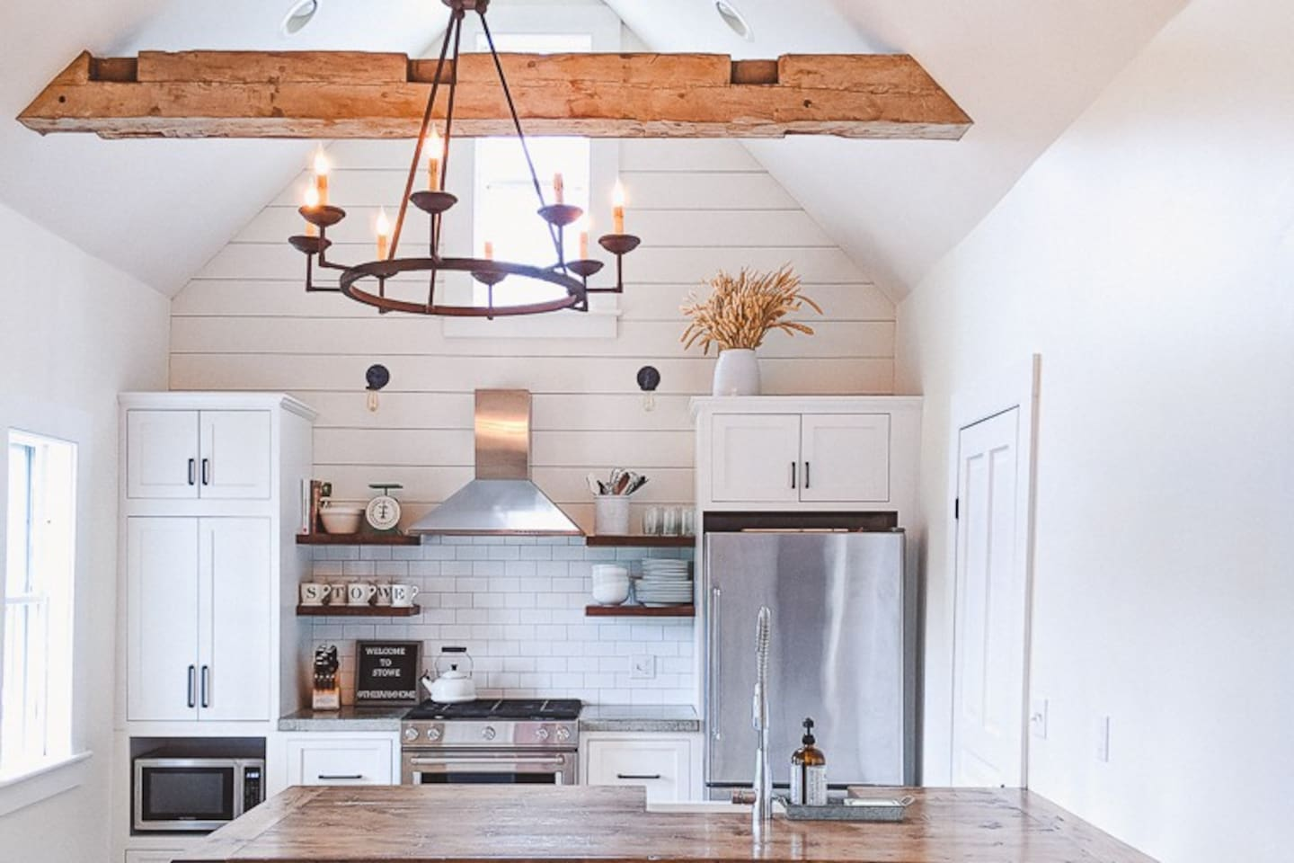 Newly renovated kitchen - concrete countertops, farmsink, hand-hewn beams, and reclaimed wood peninsula - make for a great hang-out spot for families & friends.