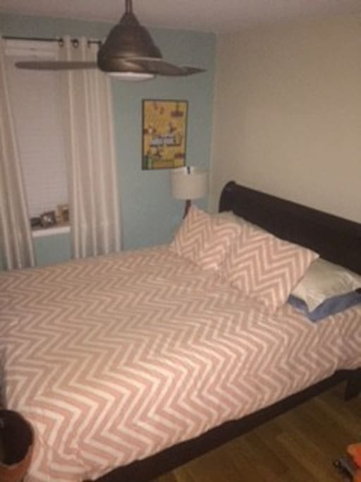 Upstairs bedroom with closet and drawer space.