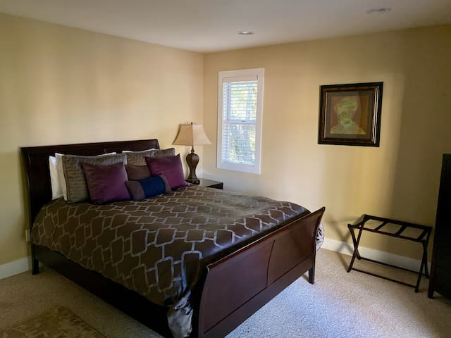 Bedroom #4 with direct access to deck overlooking creek.