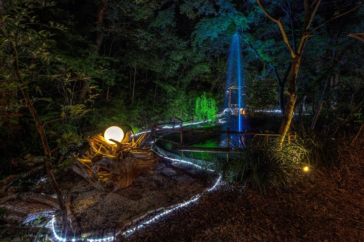 The entire property lights up at night to transform the surroundings into an enchanted forest