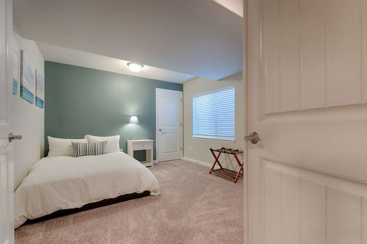 Full size memory foam mattress. This bedroom is located on the lower level of the home.