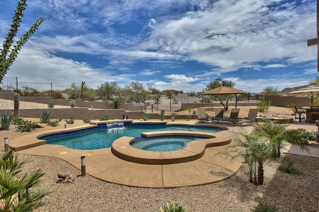 Serene desert views from everywhere in our professionally landscaped backyard.