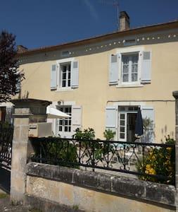 Le Cerisier, traditional riverside cottage
