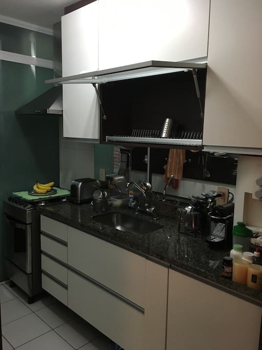 My complete kitchen with oven, refrigerator, nespresso coffee maker, laundry, dishes/glasses/cutlery
