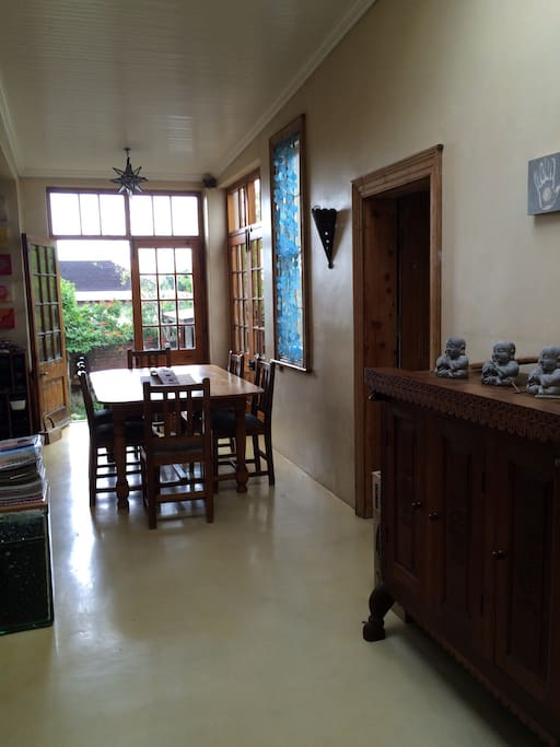The communal area alongside the kitchen has a large 6 seater dinning room table to have meals or to use as a central workstation for wifi.