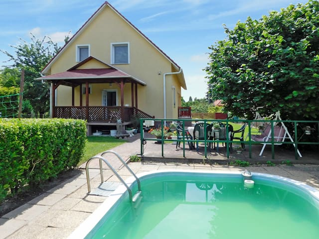 Four BDR home with lovely garden and pool