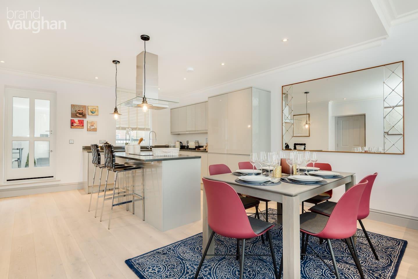 Open-plan modern kitchen with a rear terrace