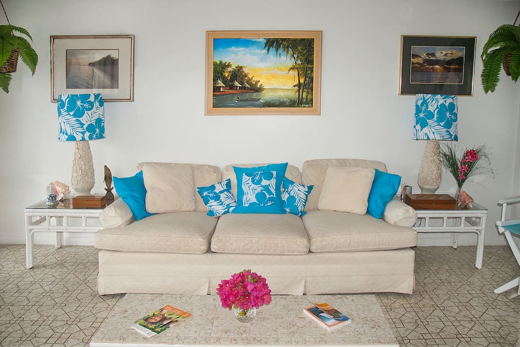 The room is very light and airy, decorated in white and natural with splashes of aqua
