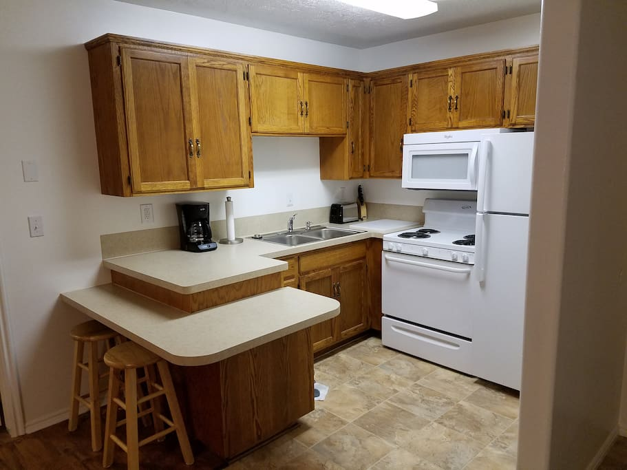 Full size frig, stove and Microwave. Fully stocked Kitchen with pots and pans and everything you need to cook your own meals.