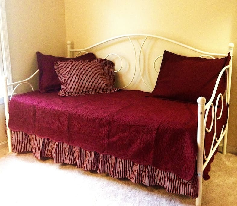 Twin daybed in the cozy  bedroom. This bed will comfortably accommodate one person.