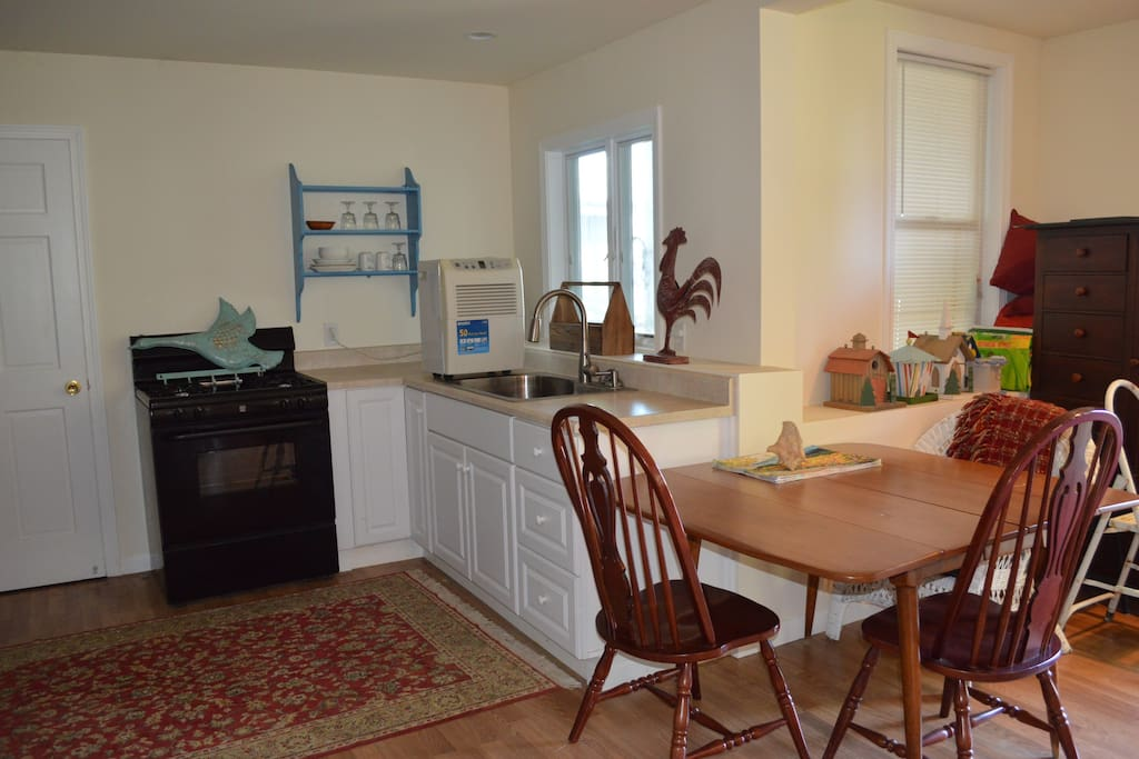 Kitchenette with stove, frig and microwave.