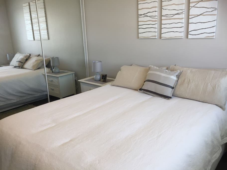 Luxurious quality pillow top queen size bed in master bedroom.   Mirrored built in wardrobe.