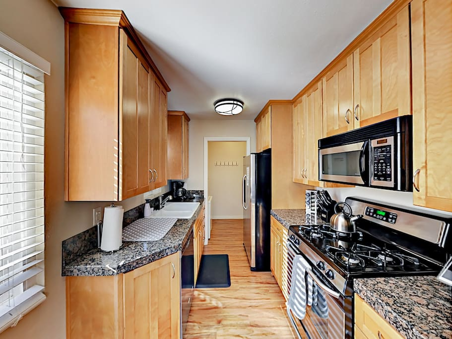 With stainless steel appliances, a large gas range, double sink, microwave, and dishwasher, making meals is a breeze.