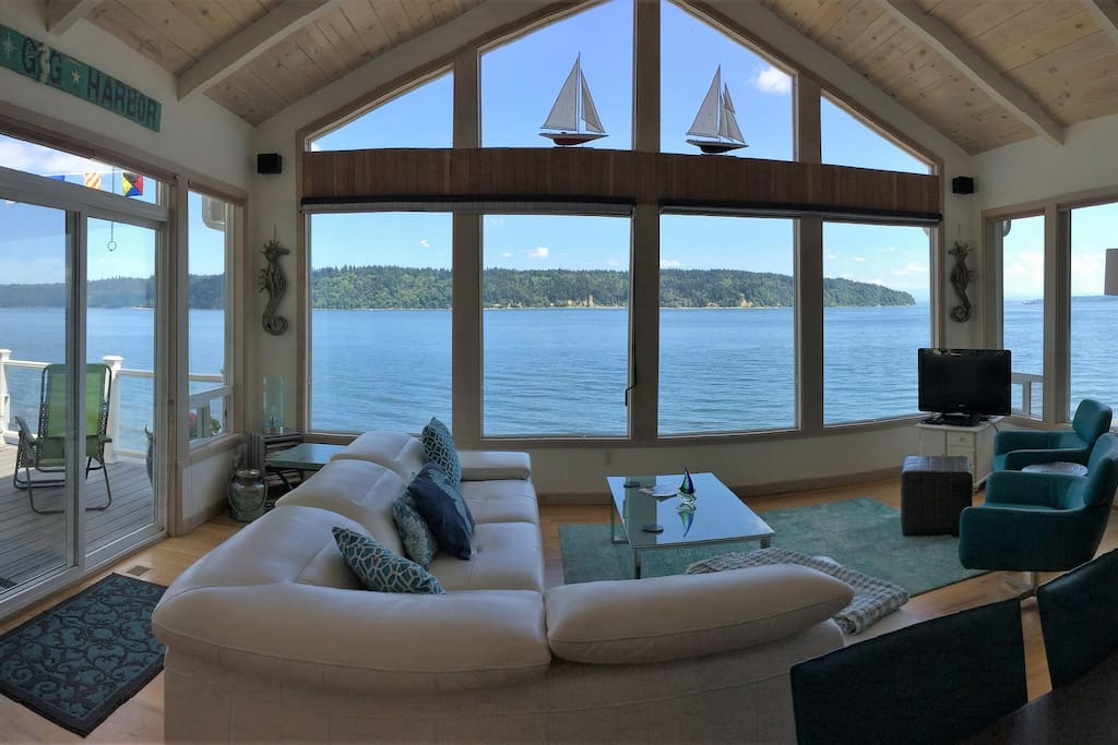 Windows galore in the open concept living area.  Showcase this sweeping and stunning view of Mt Rainier, Vashon Island to even a peak to the Tacoma Narrows Bridge