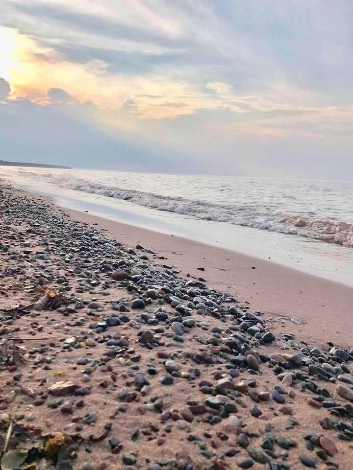 Deeded access to sandy shoreline.