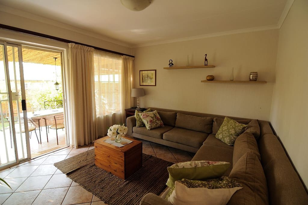 Living area with access to patio and private garden