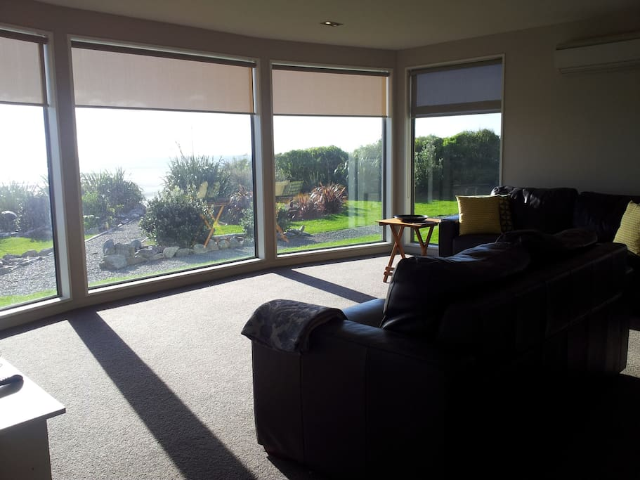Living room view across garden to sea - excellent walking beach at end of shingle path in photo