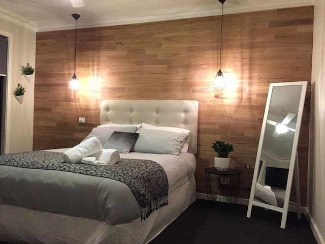 Tastefully styled bedroom with its own TV