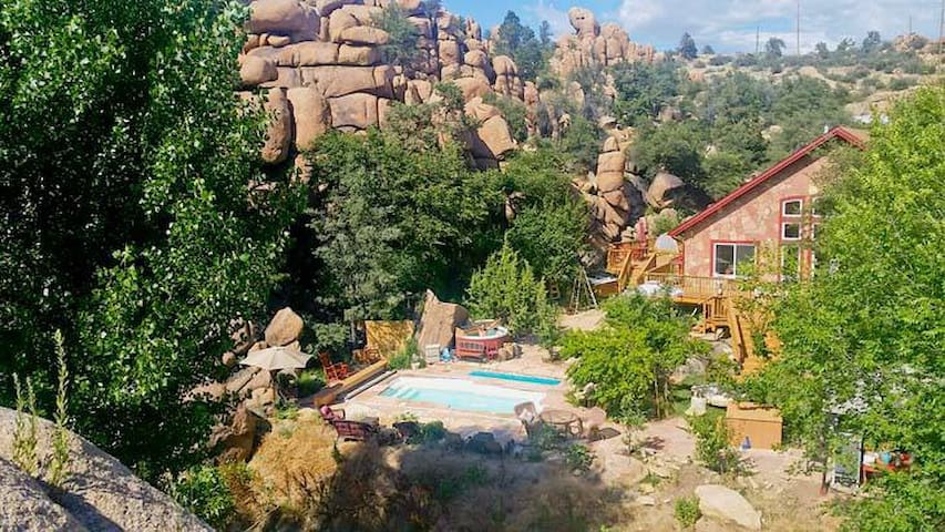 Seen from the Cave Castle cliff, Heaven on Earth's adjacent Cliff Chalet. Please feel free to enjoy the pool and these days new larger spa.