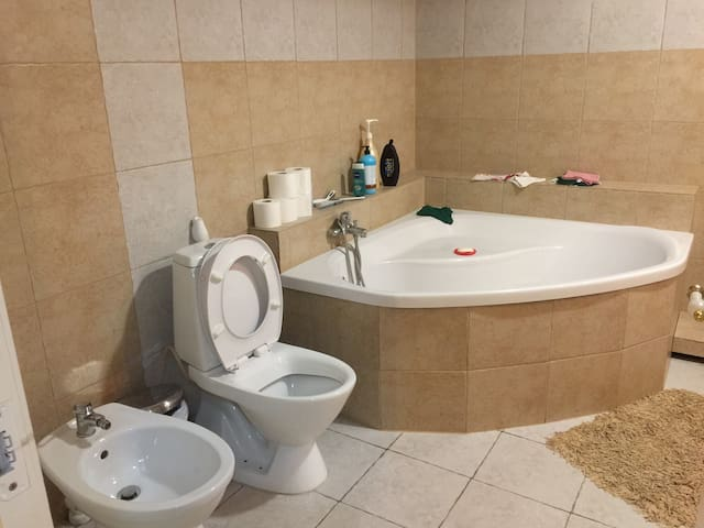 The bathroom is just next to the room.