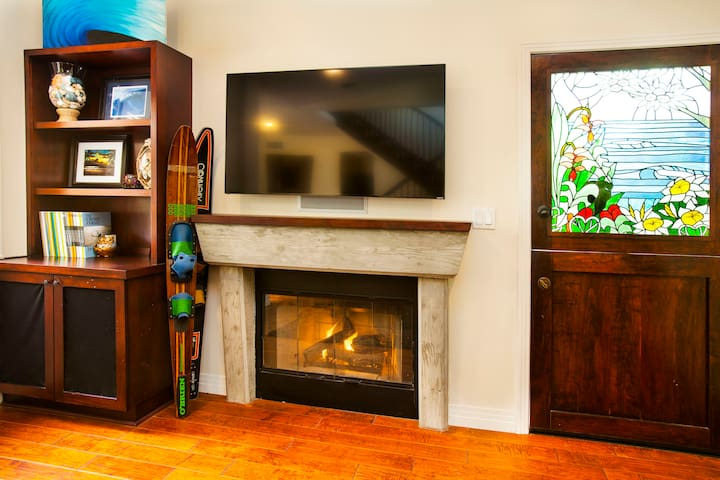 Turn on your private gas fire place. It is as easy as flipping a switch which is located on the west side of the fireplace pillar