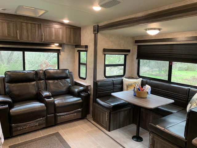 Charming new RV in a gated residence with views.