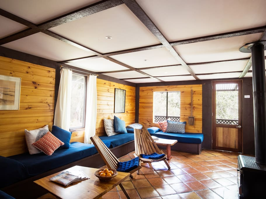 Main living room has 6 single daybeds around the log fire which is situated in the middle of the room.