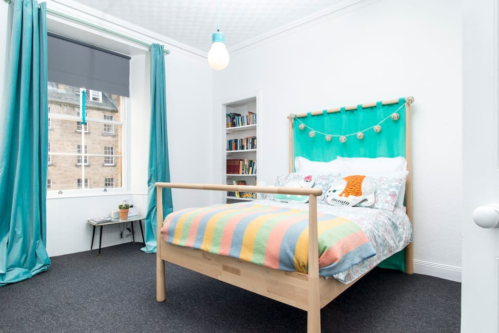 Beautiful big double bedroom with large window looking over the street. There are blackout blinds and curtains if you like a dark room to sleep in