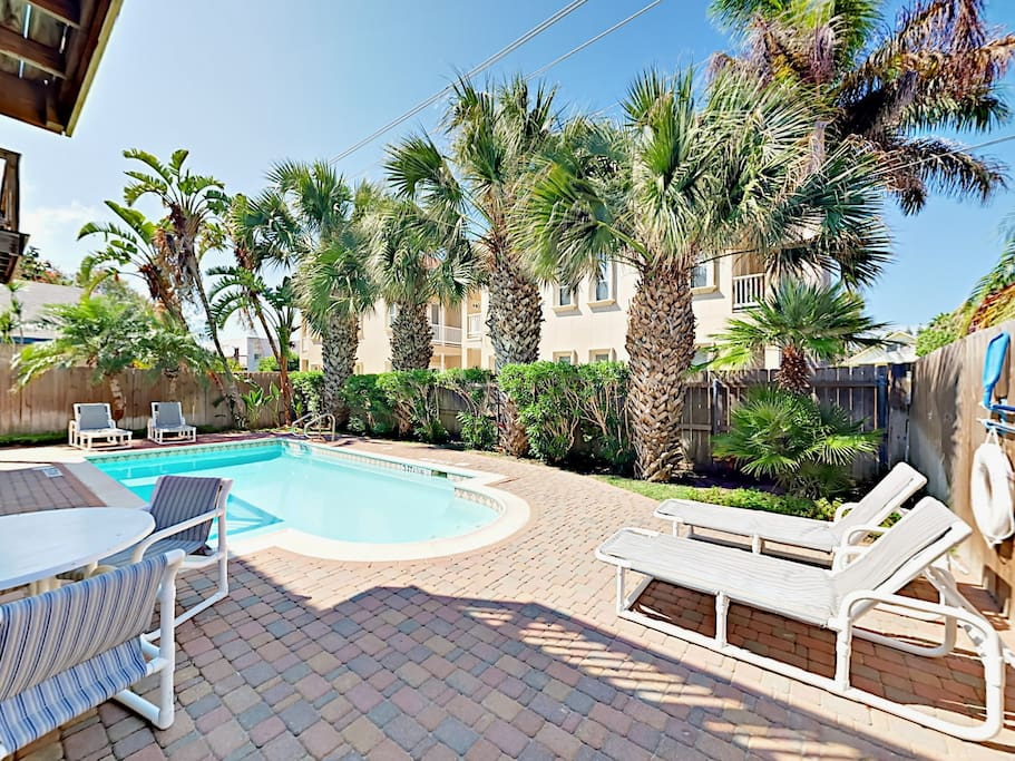 Relax at the complex pool with patio dining and poolside lounge chairs.