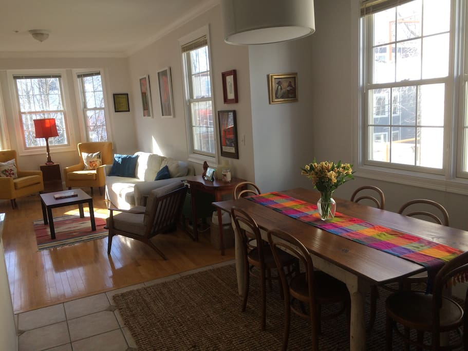 The open dining room and living room (open kitchen to the left). Second-floor views and light.