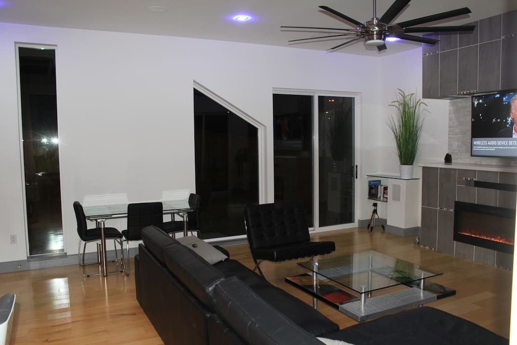 Large leather sectional and extendable dining table & chairs.