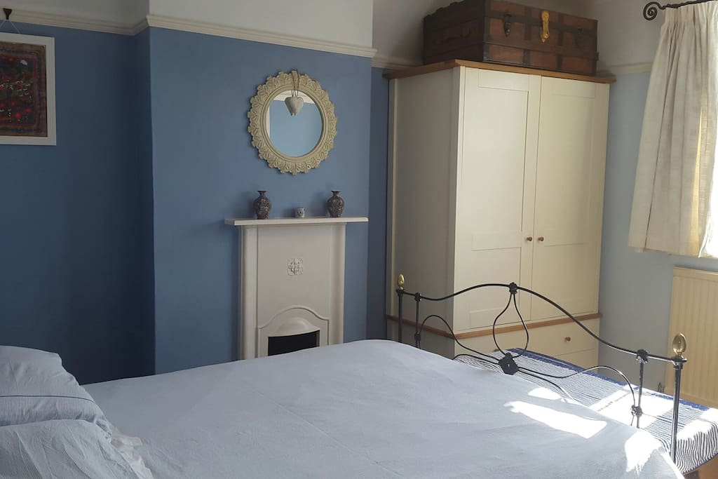 Antique cast iron bed, original fireplace and wardrobe (with plenty of storage space for guests)