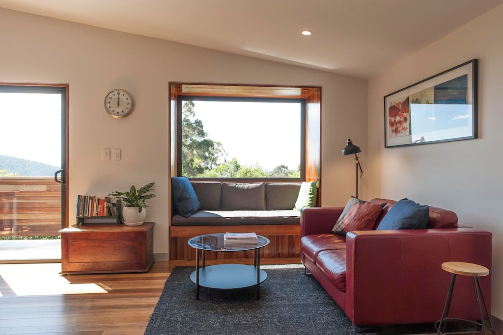 Living room with reading nook to sit and enjoy the sun and view or curl up with a book