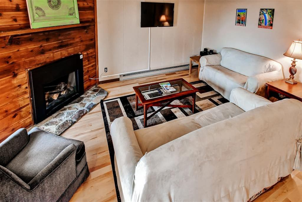 Kick back in the living room next to the cozy gas fireplace and watch your favorite cable show on the flat screen TV