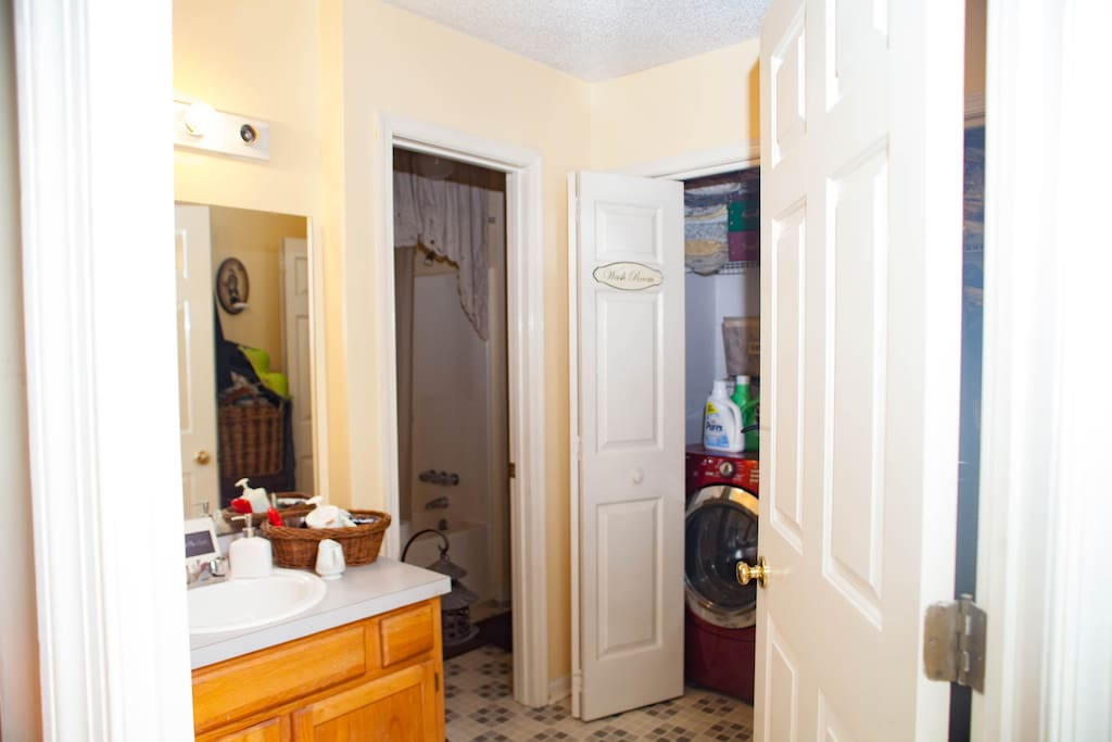 Guest bathroom with vanity, shower, tub