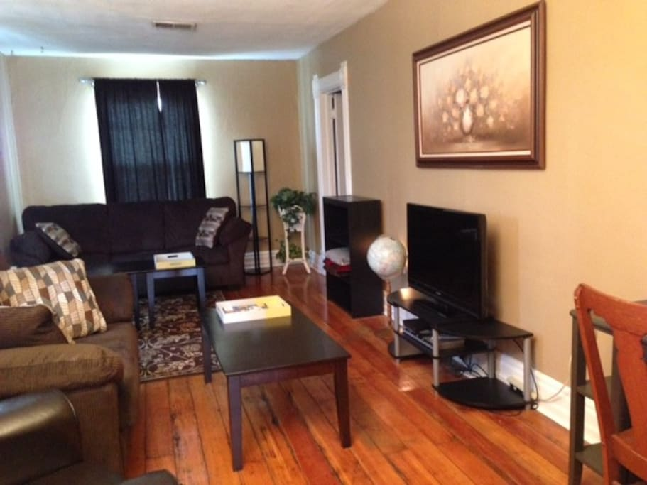 Comfortable living room with queen sofa bed, love seat, and cozy leather chair.  Desk available in corner.  Directv and wireless provided.
